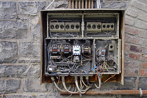 Old fuse box with chaotic cables