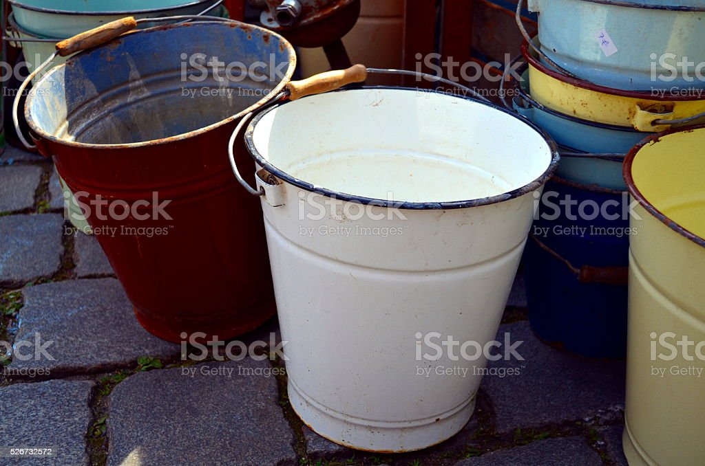 Old galvanised bucket standing at a street stock photo