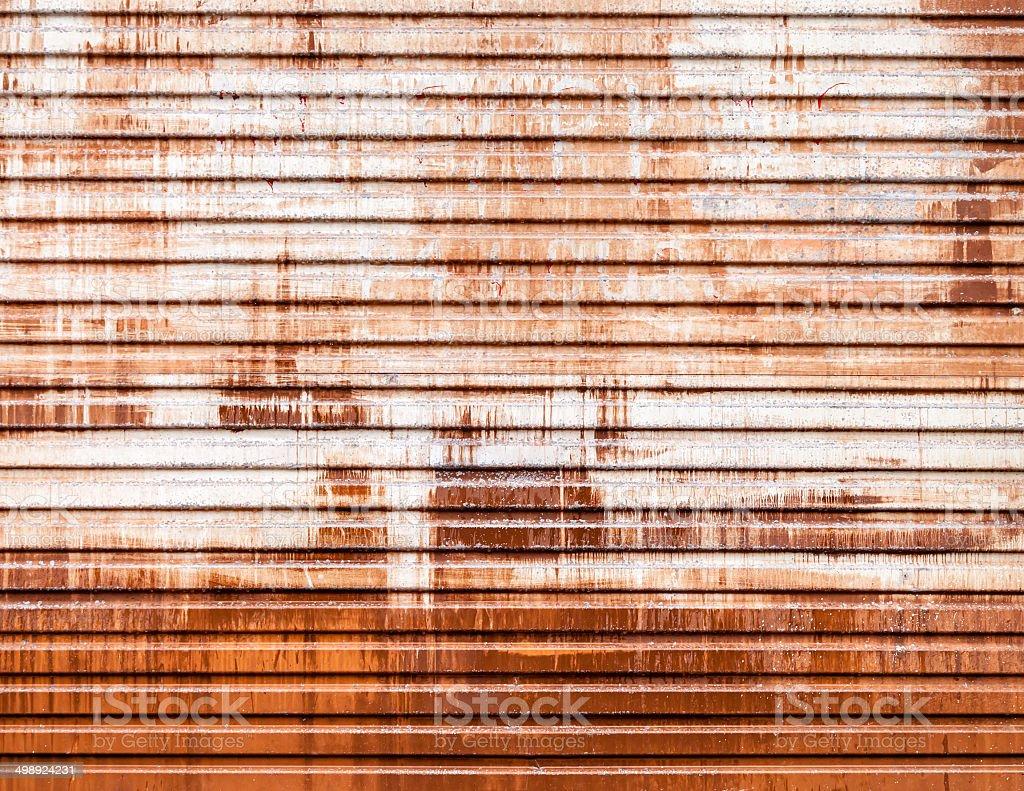 Old Garage Roller Door Streaked with Rust and Paint stock photo