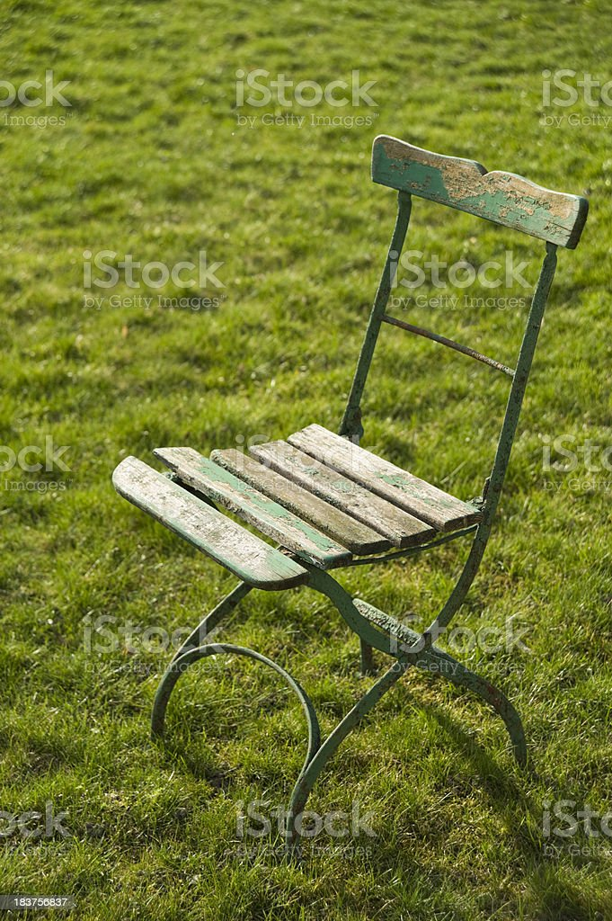 Old garden chair in front of a tree royalty-free stock photo