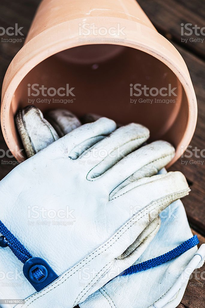 Old Gardening Gloves and Flower Pot royalty-free stock photo