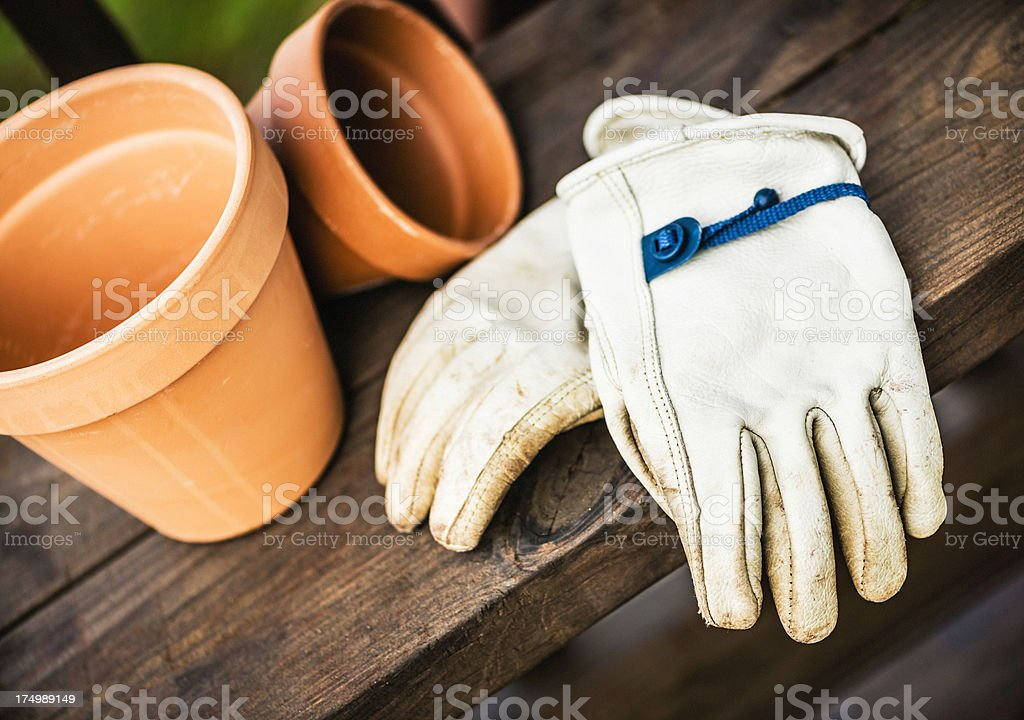 Old Gardening Gloves and Flower Pots stock photo