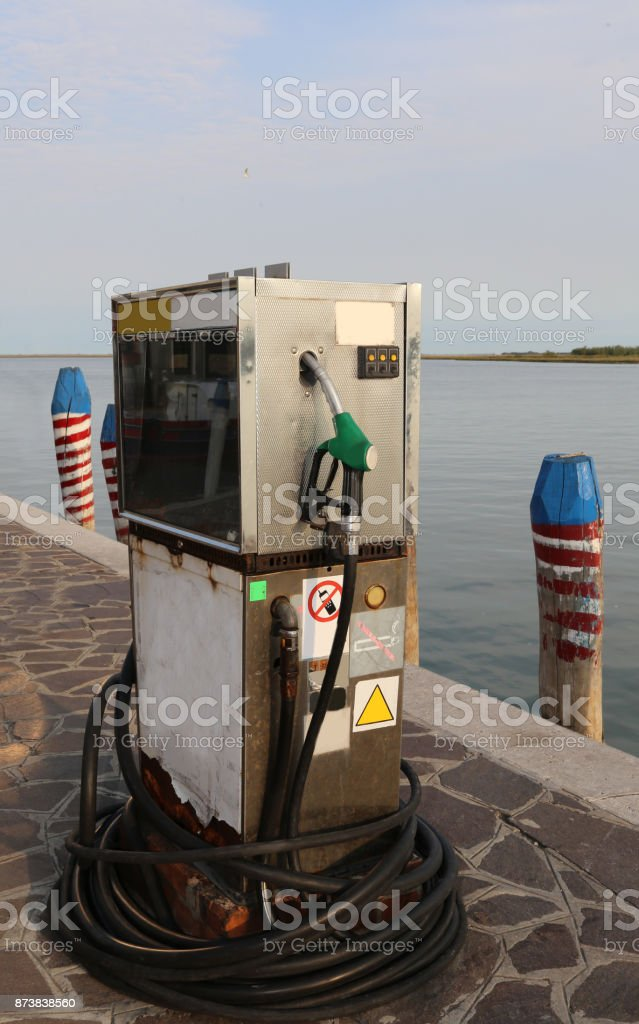 Old gas pump for filling ships stock photo
