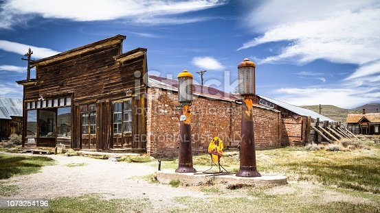 Old gas station in abandoned ghost town Bodie with bullet holes on gasoline sign, California , California