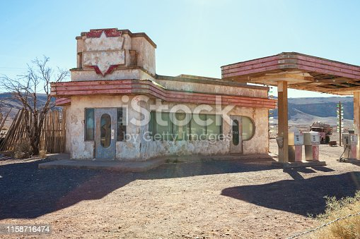 Old gas station in Sahara desert  near Ouarzazate, Morocco. Toned image.