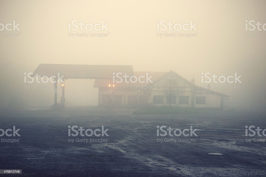 old gas station on countryside with hotel stock photo