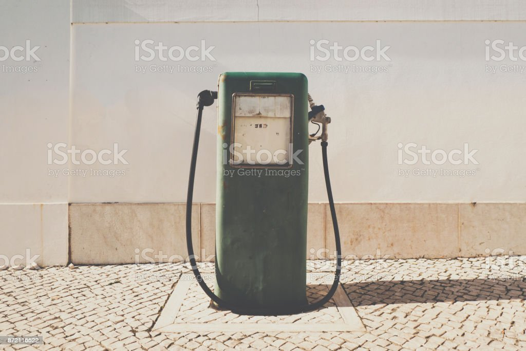 Old gasoline pump and oil dispenser stock photo
