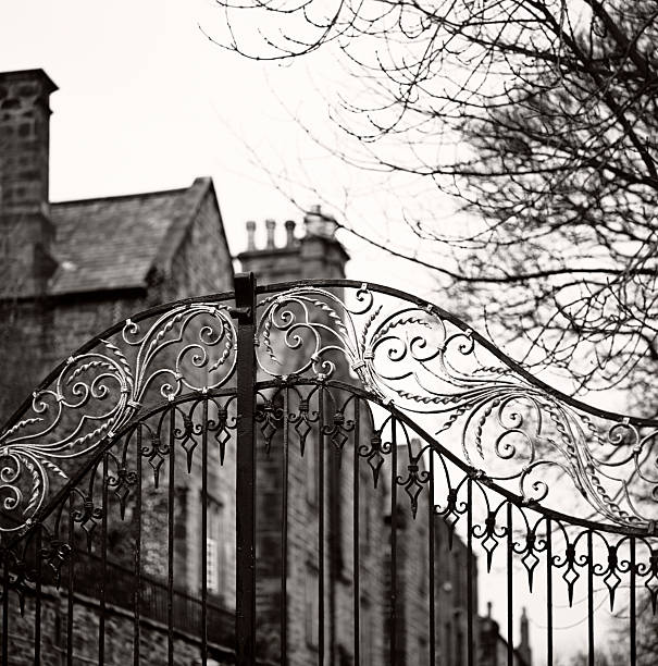 Old gate, Durham - Traditional Anglosaxon gate, closed, with mansion stock photo