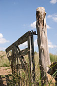 istock Old gate hanging on worn post 145194029