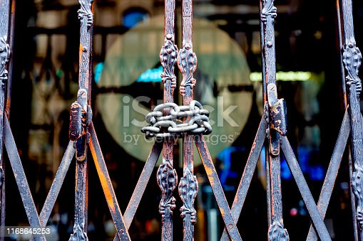 Old gate with chain, dark background with copy space, full frame horizontal composition