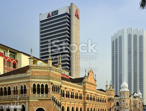 Kuala Lumpur, Malaysia: Old General Post Office with the Agro-Bank and Dayabumi towers in the background - Moorish inspired colonial architecture on Merdeka Square - designed by A.B. Hubback, the British architect who designed most of the heritage buildings in Malaysia with Moorish (Mughul) architecture - completed in 1896