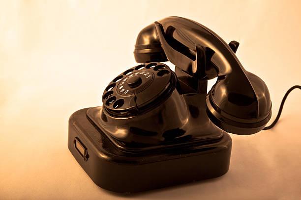 старый немецкая телефон - hand holding phone стоковые фото и изображения