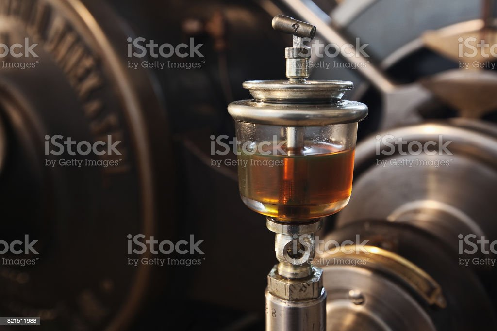 old glass oil can on historic facility stock photo