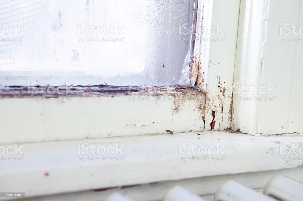 Old Glass Window in Home Needing Replacement stock photo