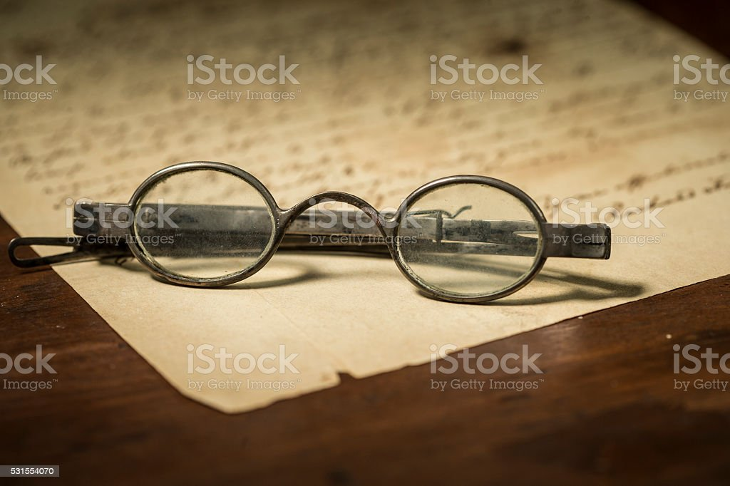 Old Glasses on a Letter stock photo