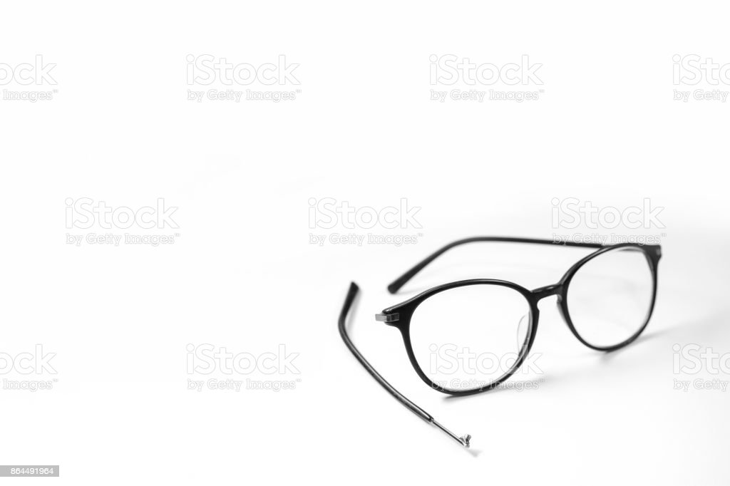Old glasses on broken legs on white background stock photo
