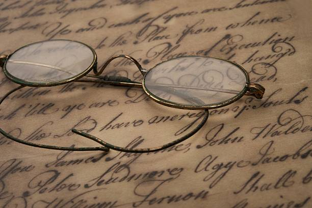 Old glasses on the vintage document stock photo