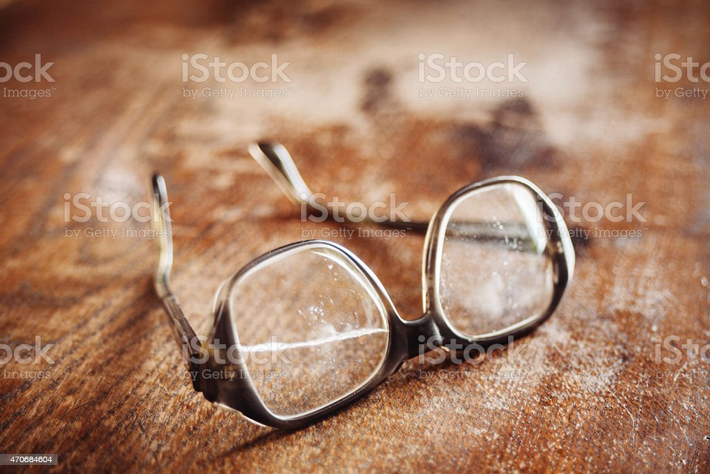 old glasses on wooden surface stock photo