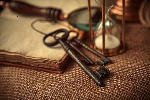 636605172 istock photo Old globe, coins, magnifying glass, keys to chests, rope, pirate map and marine logbook. Travel and marine prints background. The concept of a treasure hunter. Vintage style. 1227453162