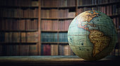 Old globe on bookshelf background. Selective focus. Retro style. Science, education, travel, vintage background. History and geography team.