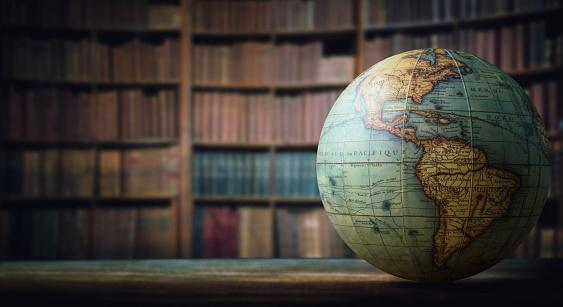 Old Globe On Bookshelf Background Stock Photo - Download Image Now