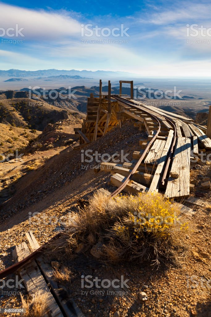 Old gold mining tracks a trestle in the Nevada desert stock photo