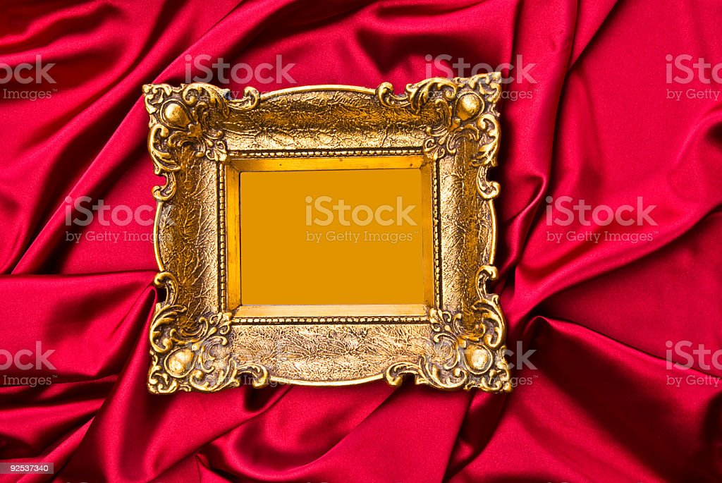 Old Gold Picture Frame On Red Satin royalty-free stock photo