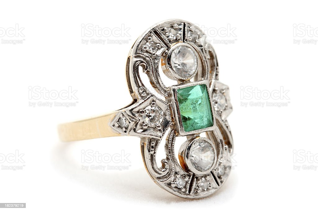 Old Gold Ring with Emerald and Diamonds on White Background stock photo