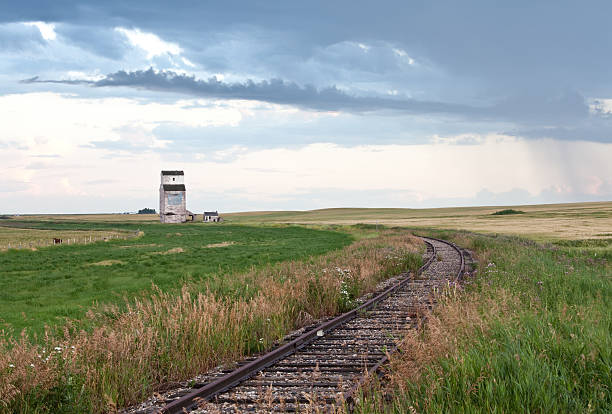 Old Grain Elevator and Railway Tracks on the Plains stock photo