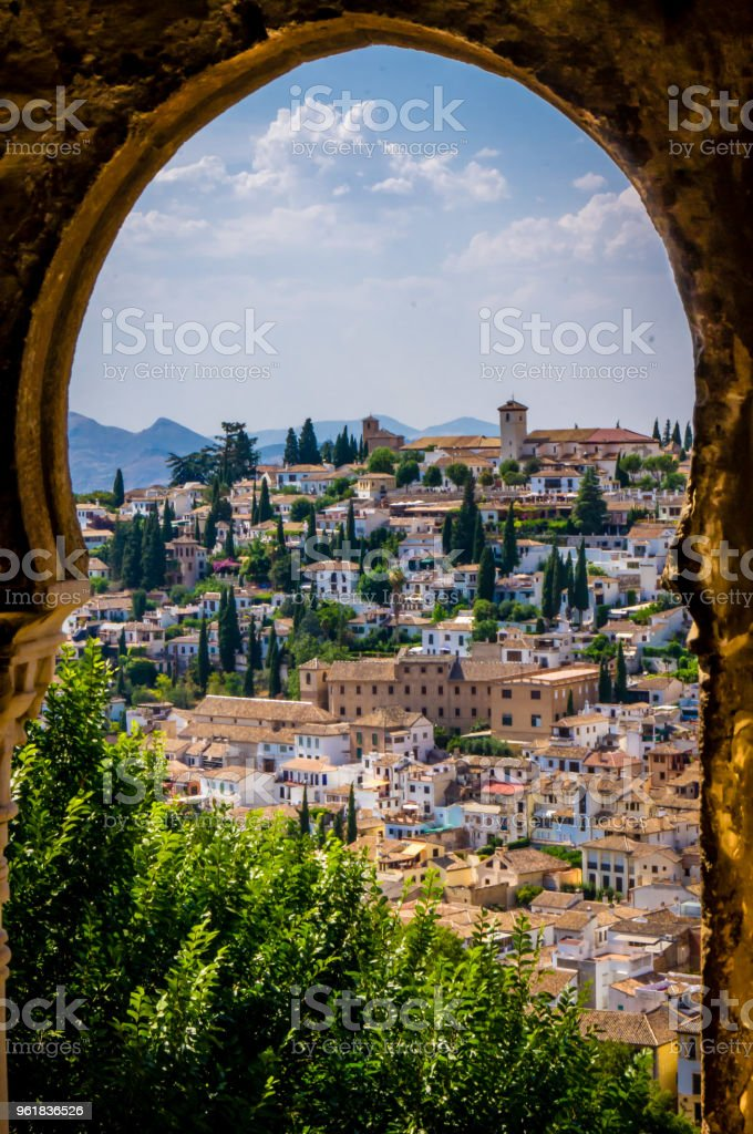 Old Granada seen from an arched window in the Alhambra stock photo
