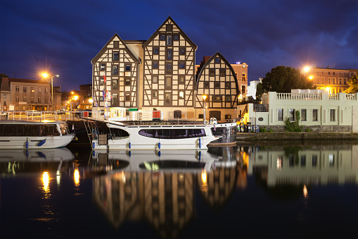 City of Bydgoszcz by night in Poland, Old Granaries at Brda river waterfront.