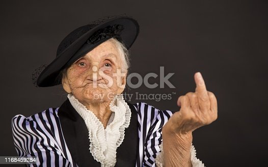 Stylish old woman in black hat