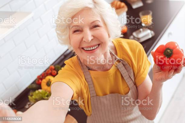 Old grandma making selfie toothy smile holding a red pepper picture id1143058006?b=1&k=6&m=1143058006&s=612x612&h=nqivxbdb0fnv7sksmknq2erghwxjhx6uev5l otzumm=