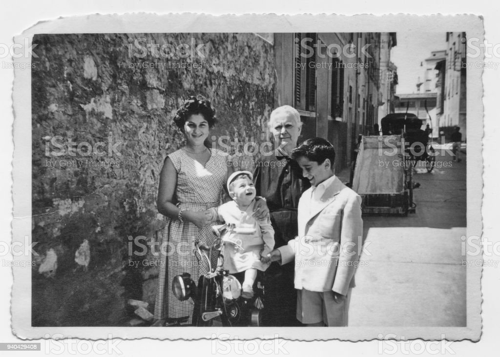 Old grandmother with grandchildren in 1952, Tuscany, Italy stock photo