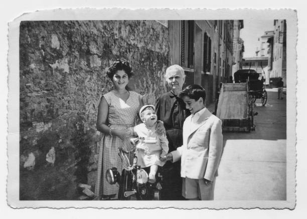 old grandmother with grandchildren in 1952, tuscany, italy - the past stock photos and pictures
