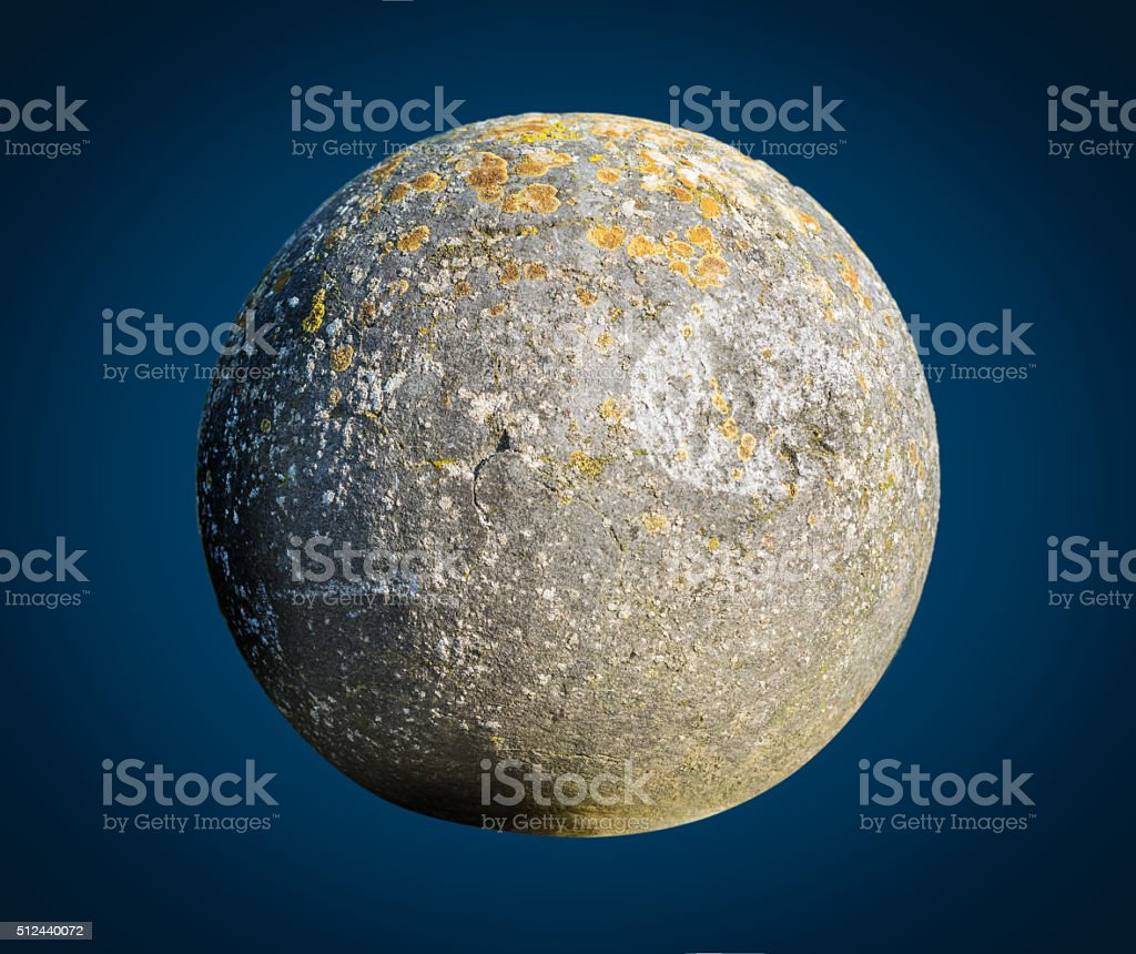 old granite ball looks like planet stock photo