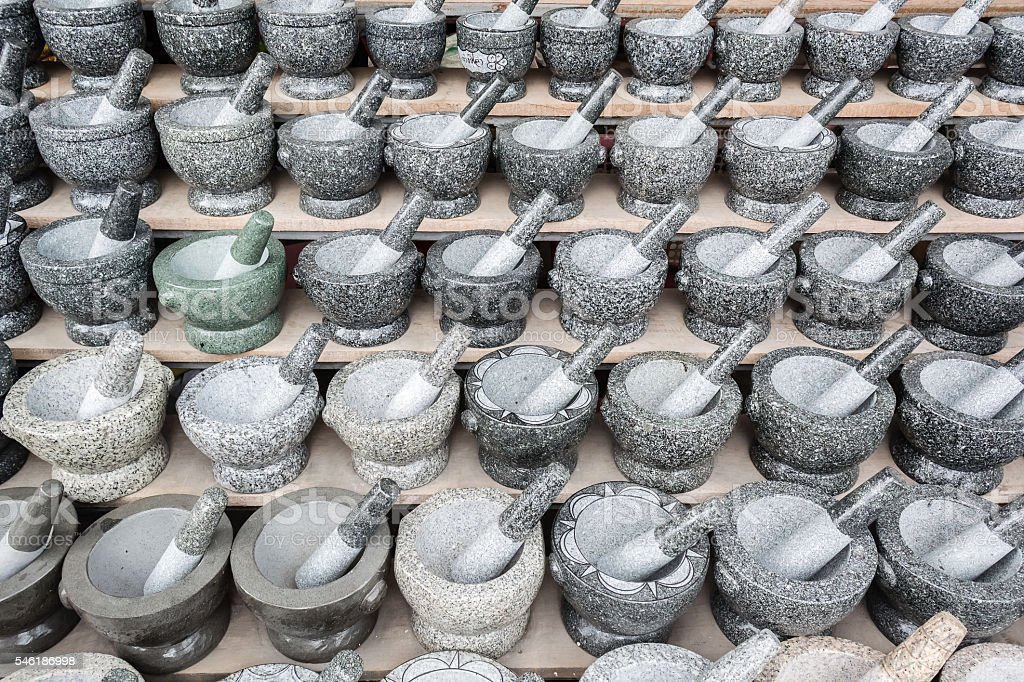 Old granite mortar with pestle stock photo