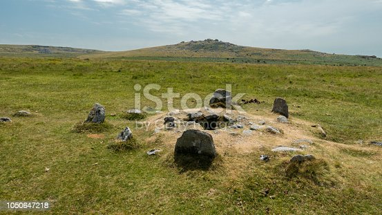 Dartmoor, a nature reserve in the south western part of England  is a unique place with wild, open moorlands and deep river valleys, with a rich history and rare wildlife. The photo shows one of the many graves in this nature reserve that date back to the iron or bronze age. Photo was taken along the B3312, east of Tavistock.