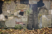 Old gravestones on wall at New Jewish cemetery in Karkow, Poland