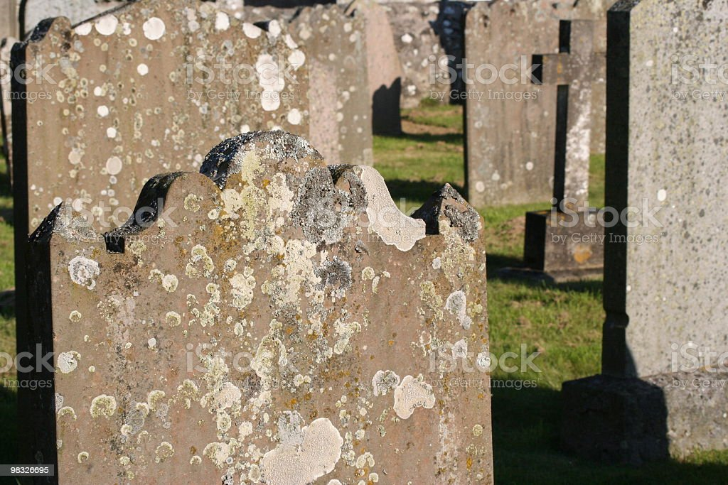 Old gravestones / tombstones in ancient Scottish graveyard / cemetery royalty-free stock photo