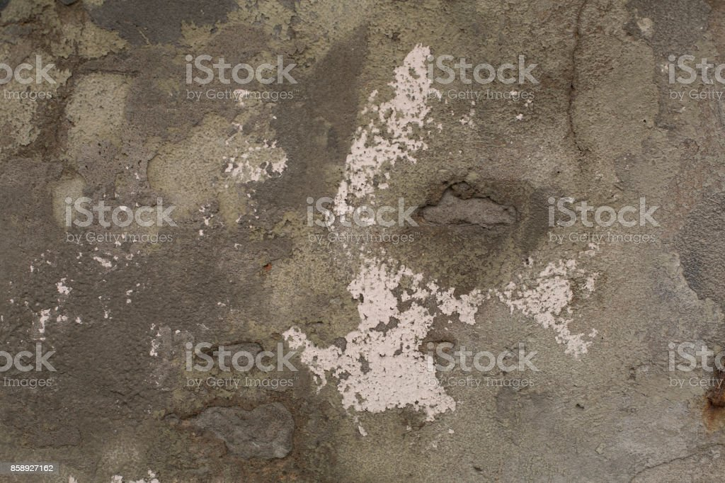 Old gray cracked plaster concrete wall texture stock photo