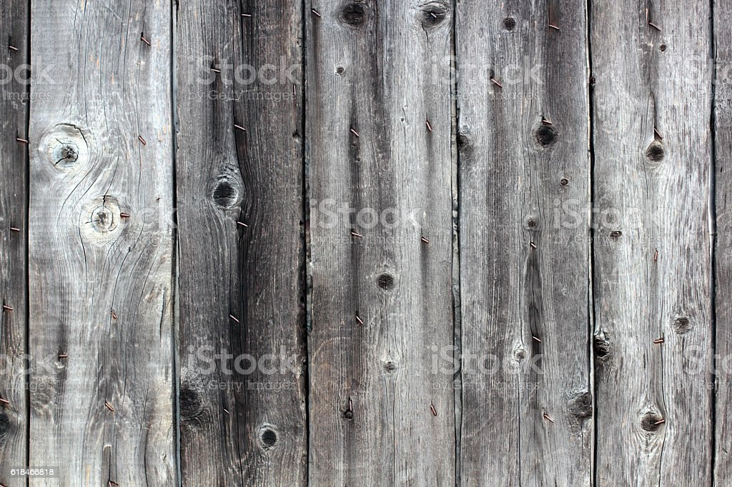 Old gray fence boards with rusty nails background stock photo