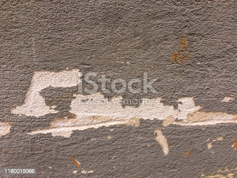 Old  gray  wall texture paint that is  is peeled is caused by low quality paint.