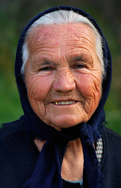 old greek lady - gold tooth stock photos and pictures