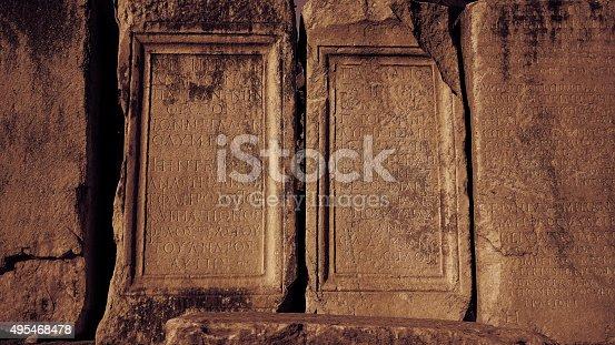 istock Old greek scriptures in Ephesus Turkey archeology background 495468478