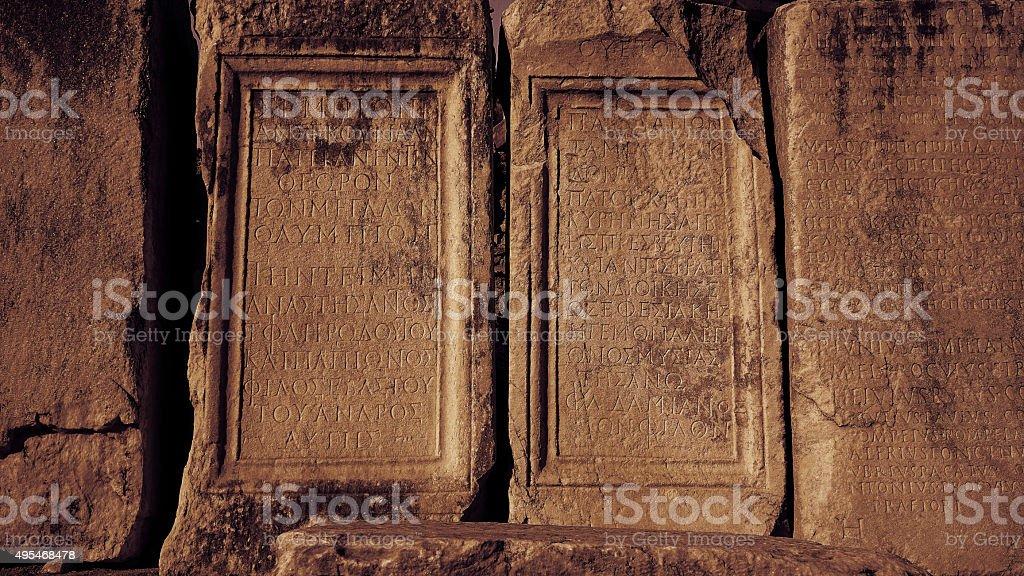 Old greek scriptures in Ephesus Turkey archeology background stock photo