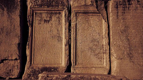 Old greek scriptures in Ephesus Turkey archeology background Old greek scriptures in Ephesus Turkey archeology background celsus library stock pictures, royalty-free photos & images