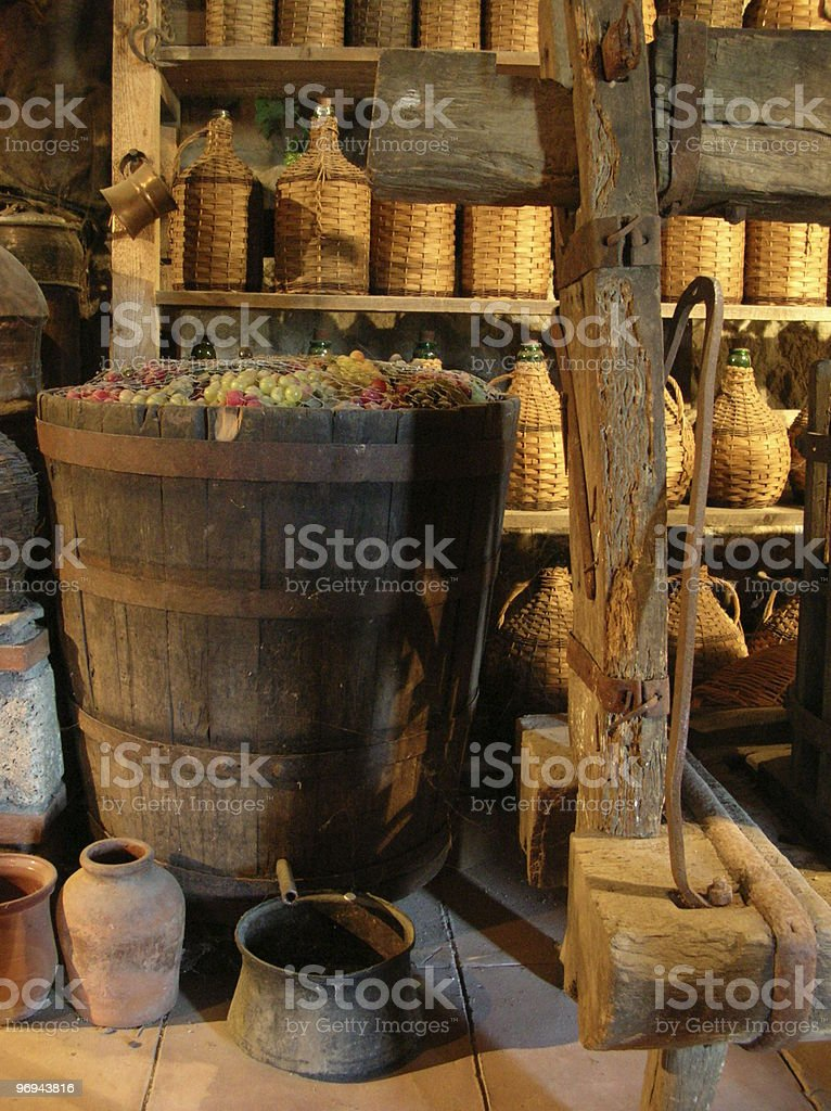old Greek vineyard with grapes in barrel royalty-free stock photo