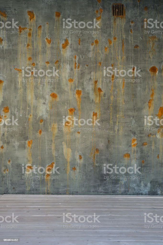 old green brown surface and concrete wall with rusted spots on white wooden floor royalty-free stock photo