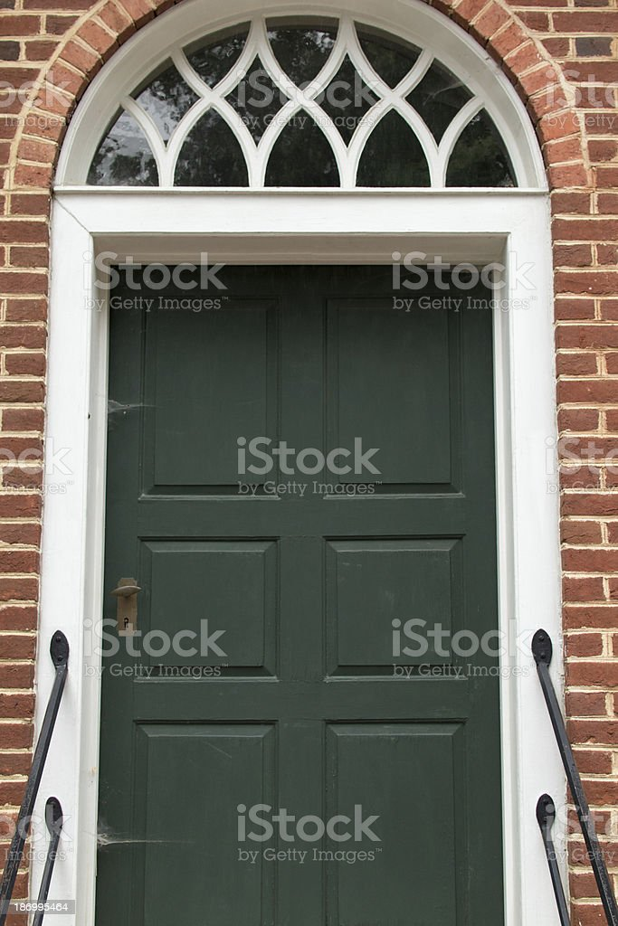 Old Green Door with Arched Transom royalty-free stock photo